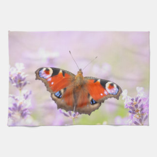 peacock butterfly over lavender hand towel