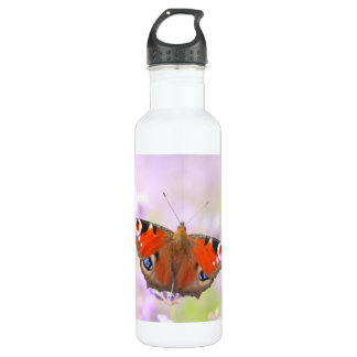 peacock butterfly over lavender water bottle