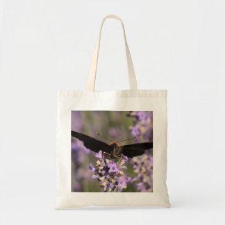 peacock butterfly sucking lavender nectar tote bag