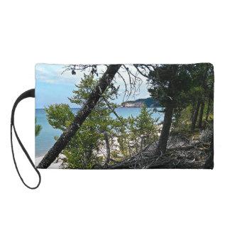 Peaking through trees wristlet purse
