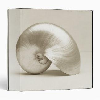 Pearlised nautilus sea shell binder