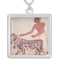 Peasant leading a cow to sacrifice silver plated necklace