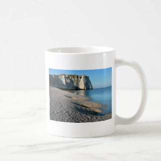 Pebble beach and cliff of Etretat in France Coffee Mug