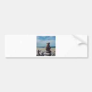 Pebble sculpture on a beach bumper sticker