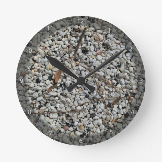 Pebble stone with dirt round wallclock