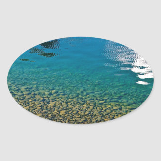 PEBBLES AND WATER REFLECTIONS OVAL STICKER