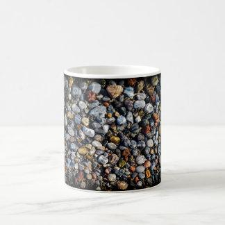 Pebbles under water coffee mug