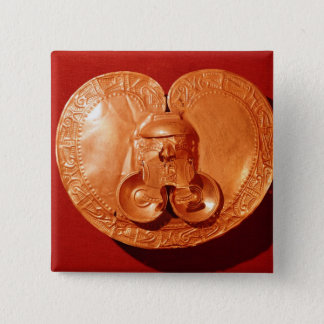 Pectoral with a human face pinback button