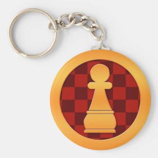 Pedazo de ajedrez del empeño del oro llaveros
