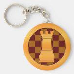 Pedazo de ajedrez del grajo del oro llaveros