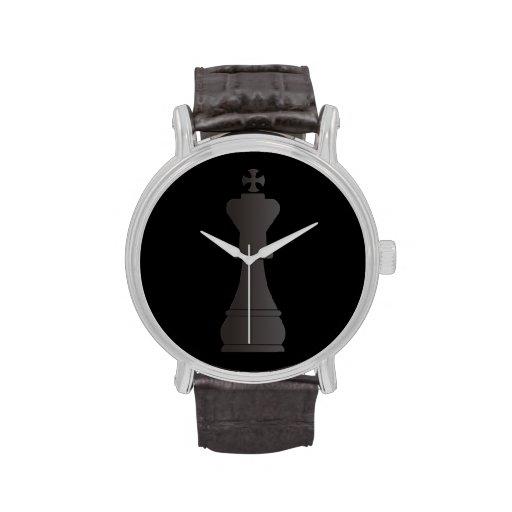 Pedazo de ajedrez negro del rey reloj