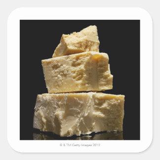 Pedazos apilados del queso de Parmasean Pegatina Cuadrada