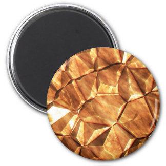 Pedazos del fondo de las pepitas de oro iman de frigorífico