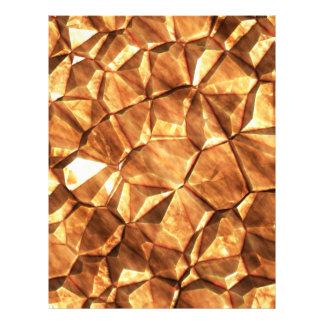 Pedazos del fondo de las pepitas de oro membrete