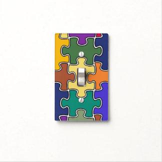 pedazos del rompecabezas del color tapa para interruptor