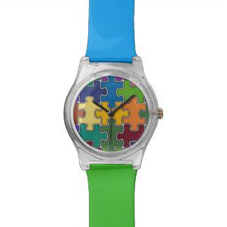 pedazos modernos del rompecabezas del color reloj