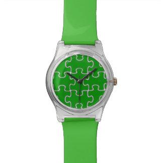 pedazos verdes modernos del rompecabezas relojes