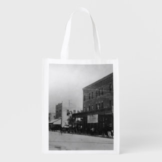 Pedestrians, cyclists, and horse-carriages grocery bag