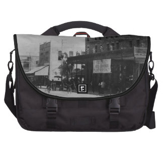 Pedestrians, cyclists, and horse-carriages laptop computer bag