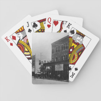 Pedestrians, cyclists, and horse-carriages playing cards