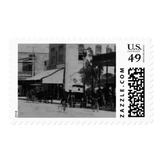 Pedestrians, cyclists, and horse-carriages postage stamp