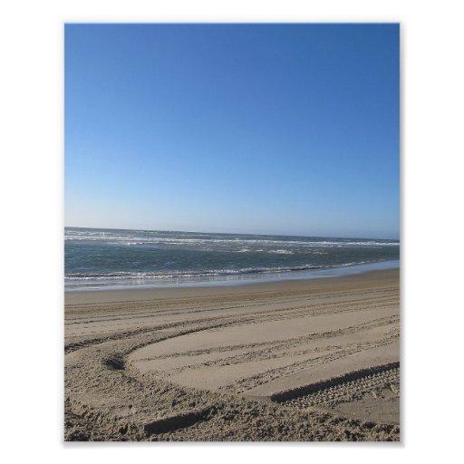 Peelin hacia fuera en la arena foto