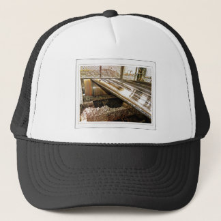 Peeping through the cage trucker hat