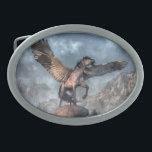 "Pegasus Oval Belt Buckle<br><div class=""desc"">A great winged horse stands atop a rocky mound. It sniffs at the cold air of a forested valley line with jagged snow-capped mountains. Its dark mane and tail whip in the wind as the Pegasus spreads it wings, ready to take flight. The Pegasus is winged horse from Greek mythology....</div>"