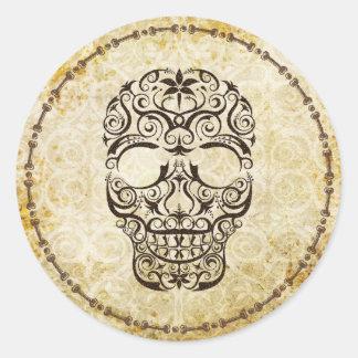 Pegatina antiguo del cráneo del cordón y de la fro