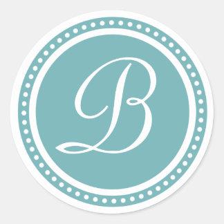Pegatina azul de la inicial del monograma del