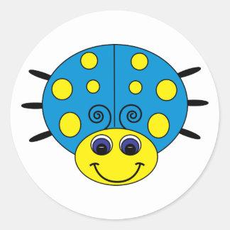 Pegatina azul y amarillo de la mariquita
