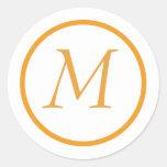 Pegatina con monograma anaranjado