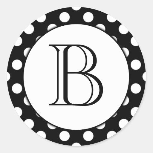Pegatina con monograma del lunar blanco y negro
