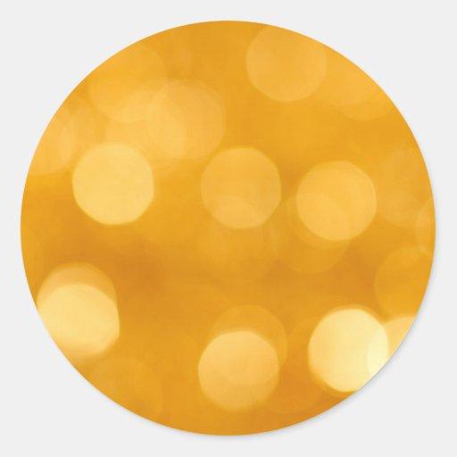 Pegatina de oro borroso del fondo