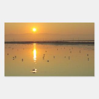 Pegatina de oro de la salida del sol
