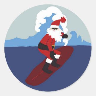 Pegatina de Santa que practica surf