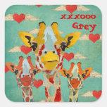 Pegatina de tres corazones de las jirafas que mira