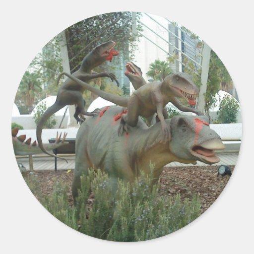 Pegatina del dinosaurio que lucha