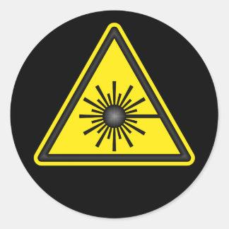 Pegatina del símbolo amonestador de laser