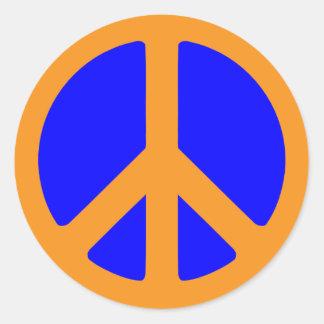 Pegatina del símbolo de paz en azul y oro