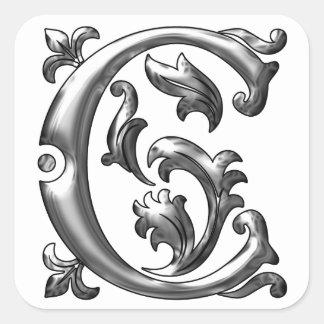Pegatina inicial de la mayúscula de C en plata