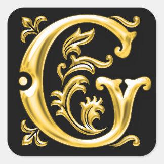 Pegatina inicial de la mayúscula de G en oro