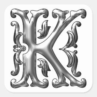 Pegatina inicial de la mayúscula de K en plata