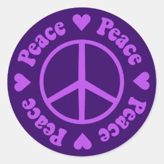 Pegatina púrpura de la paz y del amor
