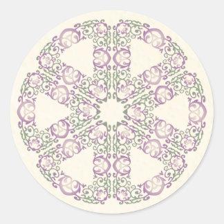 Pegatina redondo afiligranado verde y púrpura