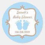 Pegatina redondo azul de los pies del bebé