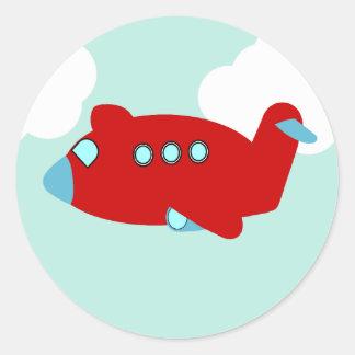 Pegatina redondo del aeroplano rojo del vuelo