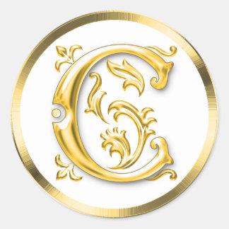 Pegatina redondo inicial de C en oro