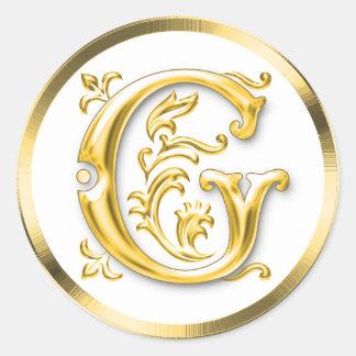 Pegatina redondo inicial de G en oro