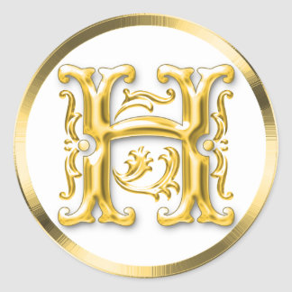 Pegatina redondo inicial de H en oro